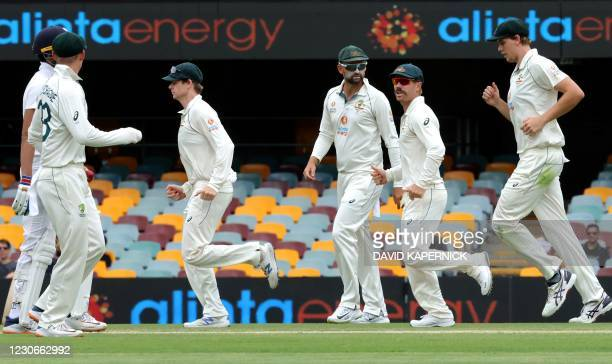 Australian players walk back to their fielding positions between the overs on day five of the fourth cricket Test match between Australia and India...