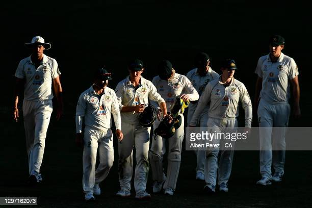 Australian players walk off the field after their defeat during day five of the 4th Test Match in the series between Australia and India at The Gabba...
