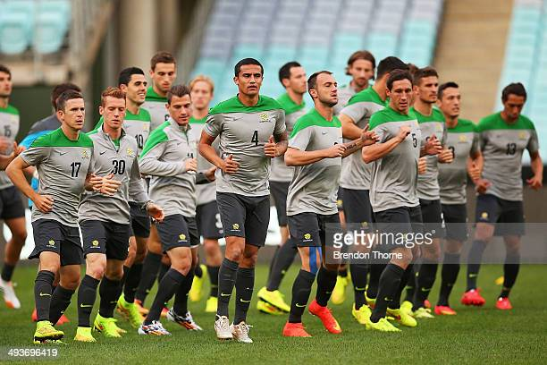 Australian players warm up during an Australian Socceroos training session at ANZ Stadium on May 25 2014 in Sydney Australia