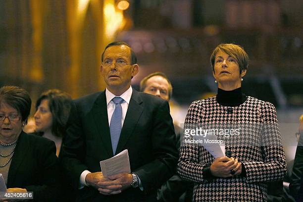 Australian PM Tony Abbott with wife Margie at the memorial service for the victims of flight MH17 at St Mary's Cathedral on July 20 2014 in Sydney...