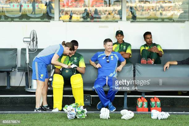 Australian PMXI coach Michael Clarke sits in the dugout with players during the T20 warm up match between the Australian PM's XI and Sri Lanka at...