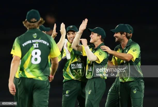 Australian PMXI players celebrate the runout of Asela Gunaratne of Sri Lanka during the T20 warm up match between the Australian PM's XI and Sri...