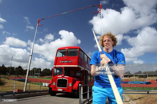 Australian pole vaulter Steve Hooker poses in front of a bus showing the height of the crossbar set to the height he cleared to win the gold medal in...
