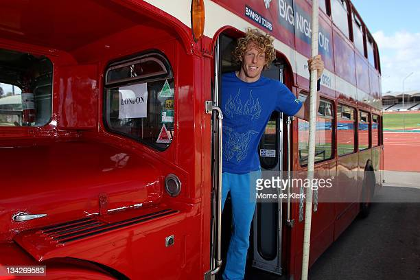 Australian pole vaulter Steve Hooker poses with a bus showing the sign for London, during an Athletics Australia press conference to announce the...