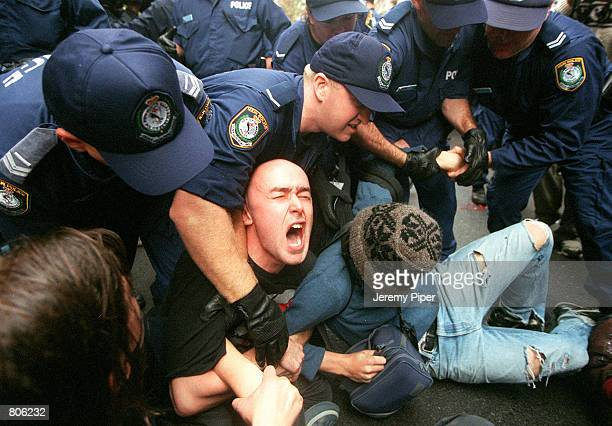 Australian police clash with antiglobalization protesters outside the Sydney Stock Exchange May 1 2001 in Sydney Australia