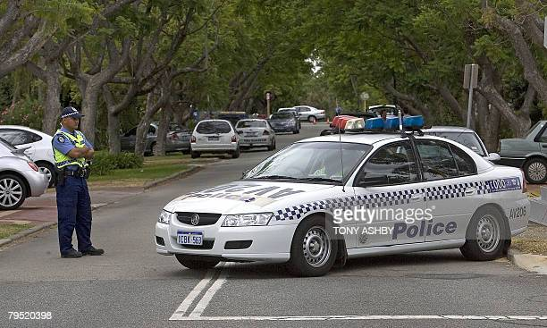 Australian police set up a roadblock at the end of the street of the late Australian actor Heath Ledger's family home in Perth on February 5 2008 The...