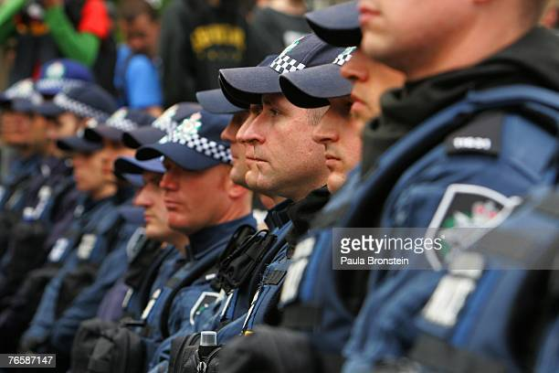 Australian police stand at attention during a 'Stop Bush Make Howard History' rally held at Sydney Town Hall September 8 2007 in Sydney Australia The...