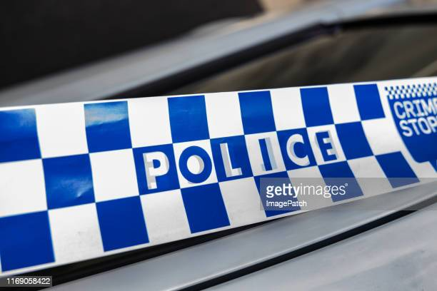 australian police tape - crime stock pictures, royalty-free photos & images