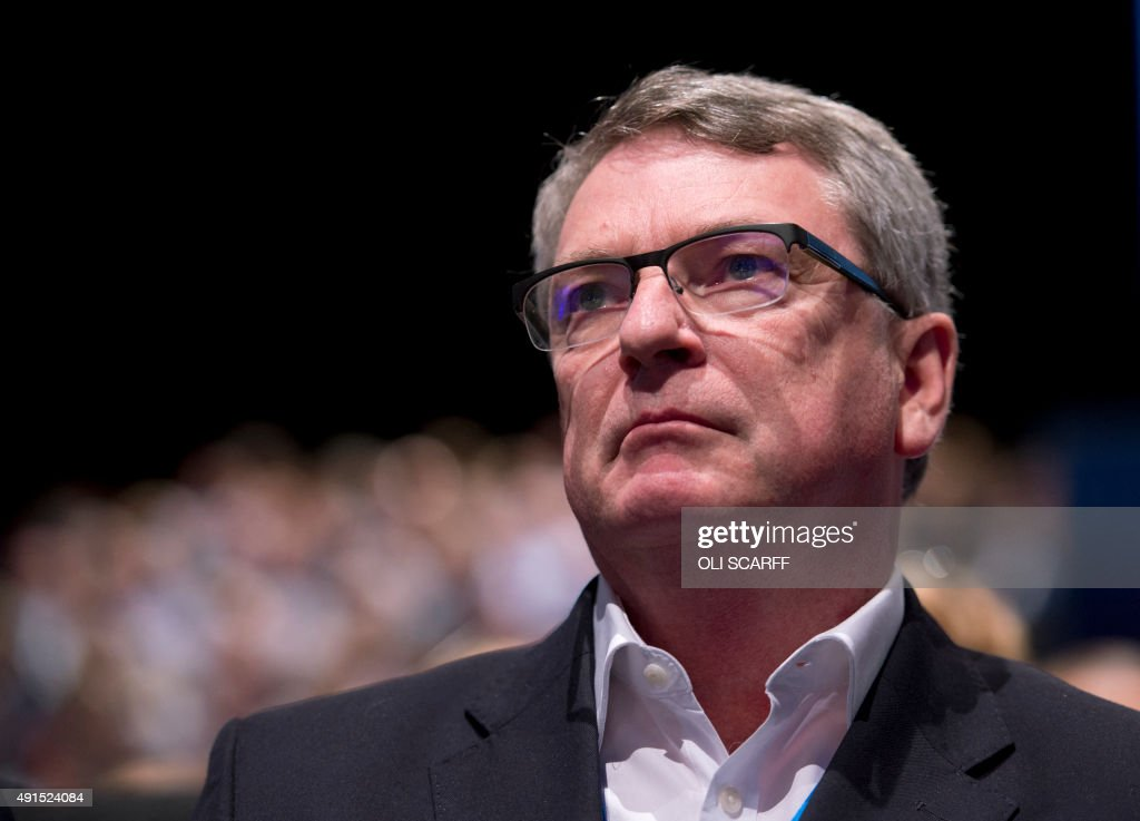 Australian political strategist Lynton Crosby listens to Conservative London Mayoral candidate Zac Goldsmith address delegates on the third day of the annual Conservative party conference in Manchester, north west England, on October 6, 2015.