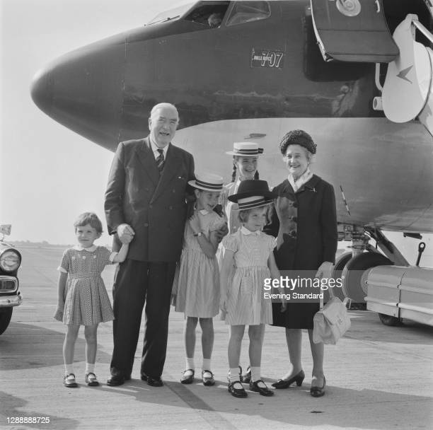 Australian politician and former Prime Minister Sir Robert Menzies at Heathrow Airport in London with his wife Pattie and their grandchildren, UK,...