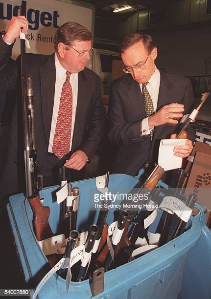 NSW Premier Bob Carr right and Police Minister Paul Whelan with the first batch of guns to be purchased as part of the gun buy backs scheme 1 October...