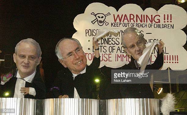 Australian politician Phillip Ruddock and Australian Prime Minister John Howard come under scrutiny by having cutouts of their faces displayed during...