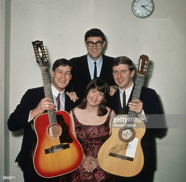 Australian pop group The Seekers. Front row are Keith Podger, Judith Duraham and Bruce Woodley. Athol Guy can be seen behind.