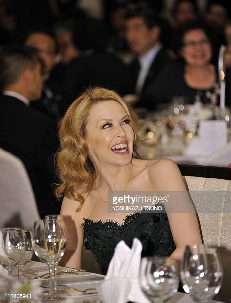 Australian pop icon Kylie Minogue laughs as she attends a fund raising dinner for the victims of the tsunami and massive earthquake in Tokyo on April...