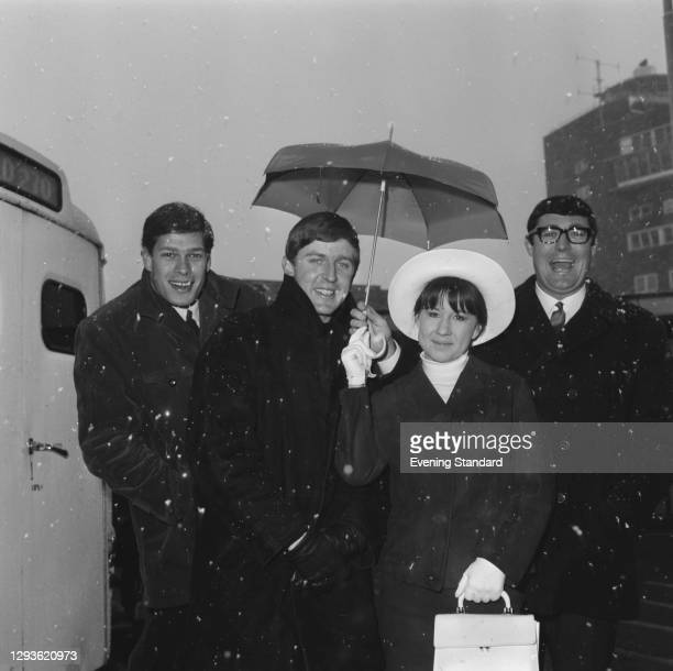 Australian pop quartet the Seekers at London Airport, UK, 1966. From left to right, they are Keith Potger, Bruce Woodley, Judith Durham and Athol Guy.