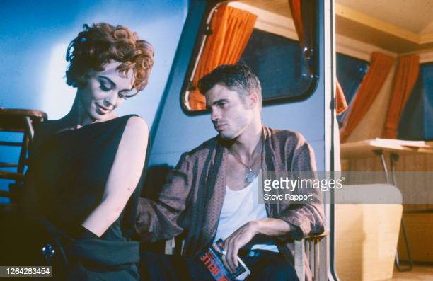 Australian Pop singer and actress Kylie Minogue films her 'What Do I Have To Do' music video, 9/1/1990. The man at right is unidentified/