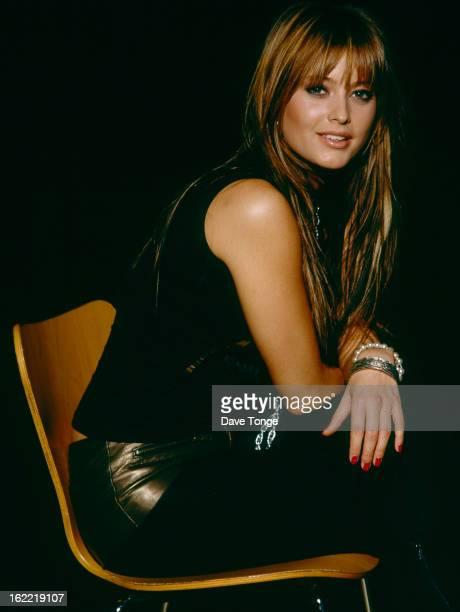 Australian pop singer Holly Valance poses for portraits London 2002