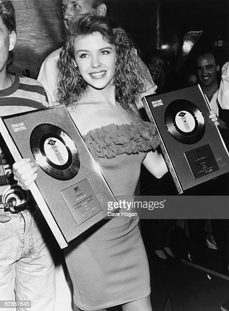 Australian pop singer Kylie Minogue with two gold discs at a press conference at Maxim's in London 6th July 1988 The awards are for her singles 'Got...