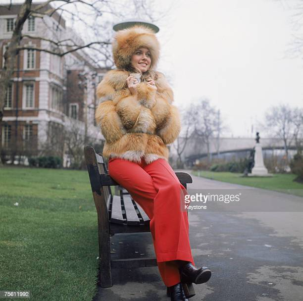 Australian pop singer Olivia Newton-John wearing a heavy fur coat outside the Savoy Hotel in London, circa 1970.