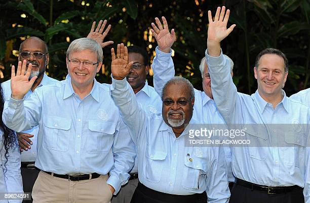 Australian Prime Minister and PIF Chairman Kevin Rudd Papua New Guinea Prime Minister Michael Somare and New Zealand Prime Minister John Key wave...