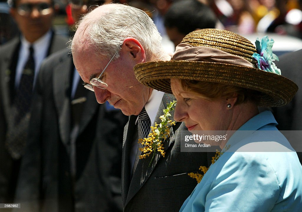 Australian Prime Minister John Howard and his wife observe the former site of the Sari Club after leaving flowers at a memorial to the victims of the Bali bombing terrorist attack October 12, 2003 in Bali, Indonesia. 202 people, including 88 Australians, were killed October 12, 2002 when a bomb was detonated in a nightclub packed with tourists.