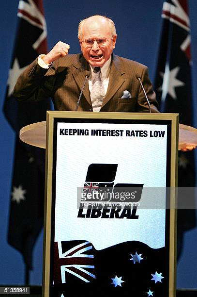 Australian Prime Minister John Howard gestures while addressing the party faithful at the coalition election campaign launch in Brisbane 26 September...