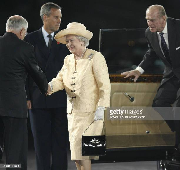 Australian Prime Minister John Howard greets Britain's Queen Elizabeth II and Prince Philip upon her arrival at the opening ceremony for the 2006...