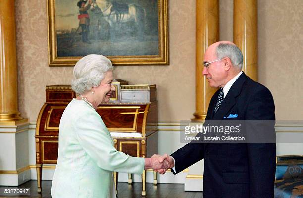 Australian Prime Minister John Howard has an audience with HM Queen Elizabeth II, The Queen, at Buckingham Palace on July 22, 2005 in London, England.