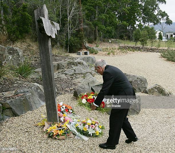 Australian Prime Minister John Howard lays a wreath at the memorial site of the Port Arthur massacre during a memorial service to mark the 10th...
