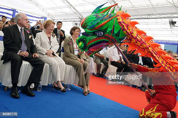 Australian Prime Minister John Howard left and his wife Janette second left watch a traditional lion dance during the opening ceremony for BlueScope...