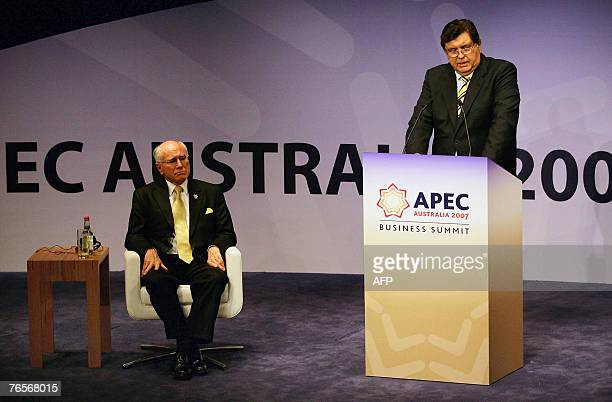 Australian Prime Minister John Howard listens as Peruvian President Alan Garcia Perez makes a speech during the business summit Peru 2008 session of...