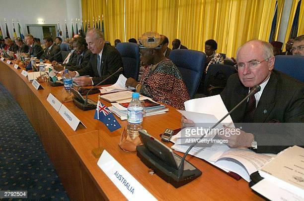 Australian Prime minister John Howard Nigerian President and Chairman of CHOGM Olusegun Obassanjo Secretary General of the Commonwealth New Zealander...