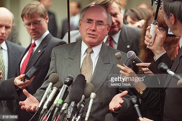 Australian Prime Minister John Howard speaks to reporters at the White House in Washington, DC, 12 July 1999 following a luncheon meeting with US...