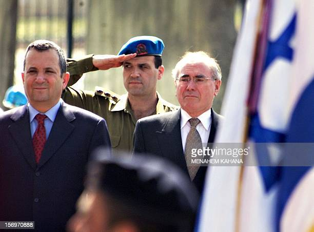 Australian Prime Minister John Howard stands next to his Israeli counterpart Ehud Barak during a welcoming ceremony 30 April 2000 in Jerusalem Howard...
