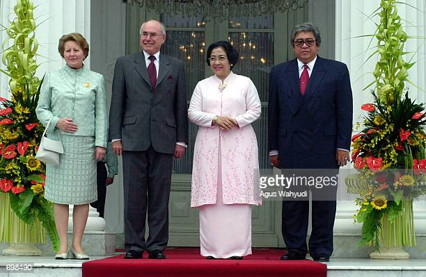 Australian Prime minister John Howard with his wife Janette and Indonesian President Megawati Sukarnoputri with her husband Taufik Kemas pose for...