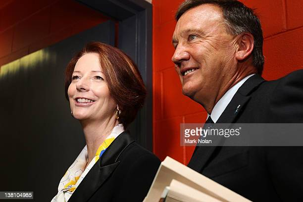 Australian Prime Minister Julia Gillard and her partner Tim Mathieson talk to the media after a team photo shoot before the International Tour Match...