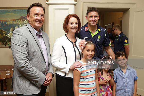 Australian Prime Minister Julia Gillard and her partner Tim Mathieson pose with Michael Hussey of Australia and his children during a function at...