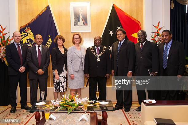 Australian Prime Minister Julia Gillard and Michael Ogio Governor General of Papua New Guinea pose for pictures with other officials in Port Moresby...