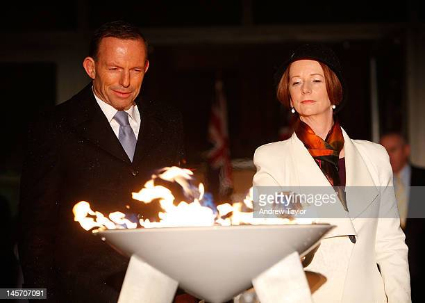 Australian Prime Minister Julia Gillard and opposition Leader Tony Abbott jointly light a ceremonial beacon to mark the Queen's Diamond Jubilee at...