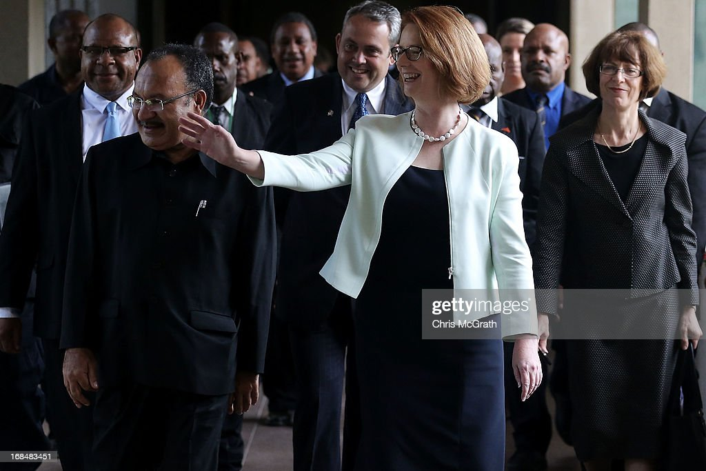 Australian Prime Minister Julia Gillard and Papua New Guinea Prime Minister Peter O'Neill walk to a press conference at Parliament House on May 10, 2013 in Port Moresby, Papua New Guinea. The three-day visit is a chance for the two nations to strengthen economic ties, with talks being held on key issues including, trade, military defense, and the controversial Australian detention center on Manus Island.The trip is the first official visit for Prime Minister Julia Gillard to the Pacific Island Nation and the first visit since former prime minster Kevin Rudd visited in 2007.