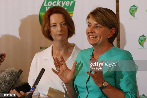 Australian Prime Minister Julia Gillard and Queensland Premier Anna Bligh talk to media during a press conference in the Shire Hall on January 10...