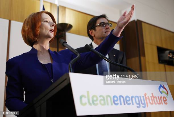 Australian Prime Minister Julia Gillard and the Minister for Climate Change and Energy Efficiency Greg Combet talk during the government's...