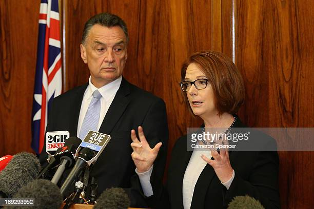 Australian Prime Minister Julia Gillard and Transport and Main Roads Minister Scott Emerson speak to media during a press conference on May 23 2013...