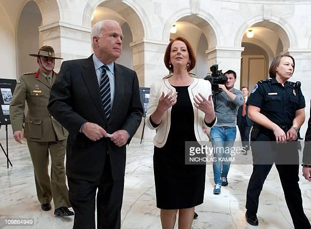 Australian Prime Minister Julia Gillard and US Republican Senator from ArizonaJohn McCain tour a photo exhibition in the Russell Senate Building...