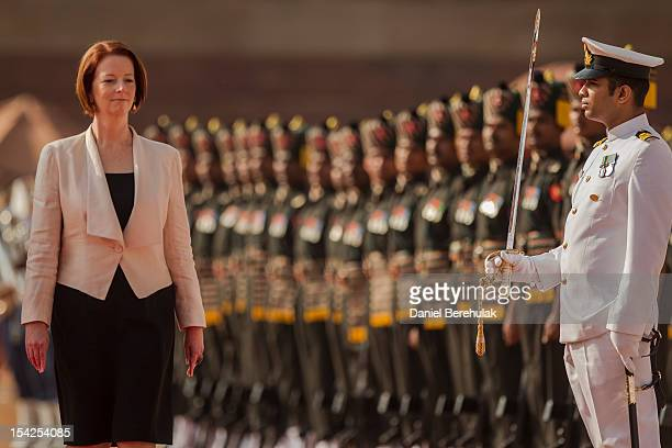 Australian Prime Minister Julia Gillard inspects the guard of honour during her ceremonial reception at the Indian presidential palace Rashtrapati...