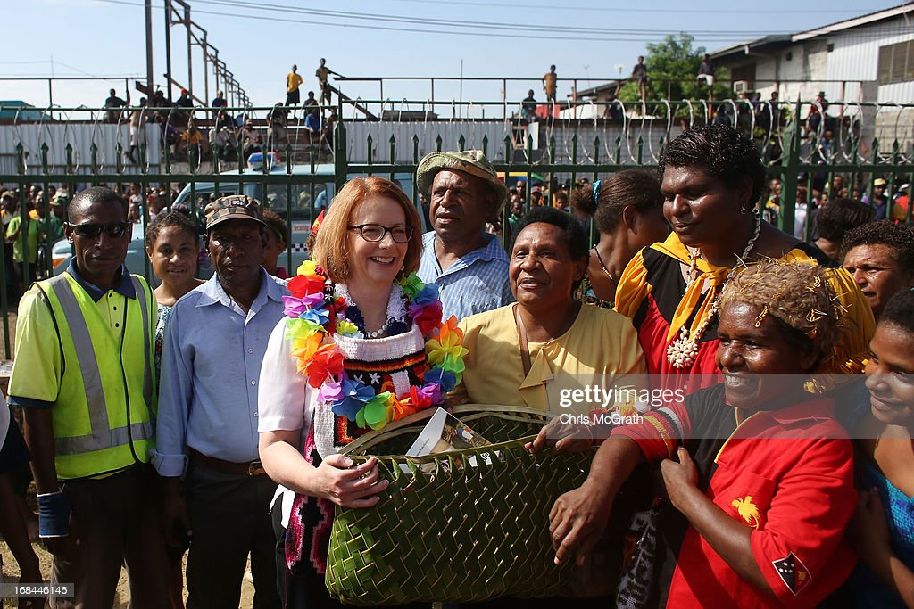 Australian Prime Minister Julia Gillard is given a new bag during a tour of the Gerehu Market on May 10, 2013 in Port Moresby, Papua New Guinea. The three-day visit is a chance for the two nations to strengthen economic ties, with talks being held on key issues including, trade, military defense, and the controversial Australian detention center on Manus Island. The trip is the first official visit for Prime Minister Julia Gillard to the Pacific Island Nation and the first visit since former prime minster Kevin Rudd visited in 2007.