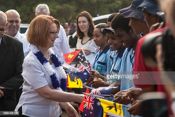 Australian Prime Minister Julia Gillard is welcomed into Gerehu market in Port Moresby by schoolchildren during her trip to Papua New Guinea on May...
