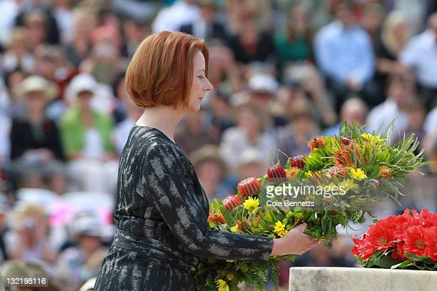 Australian Prime Minister Julia Gillard lays a wreath at the Remembrance Day Commemoration Service at the Australian War Memorial on November 11 2011...