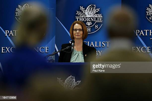 Australian Prime Minister Julia Gillard listens to a question from a member of the public at Thornlie Senior High School on March 27 2013 in Perth...