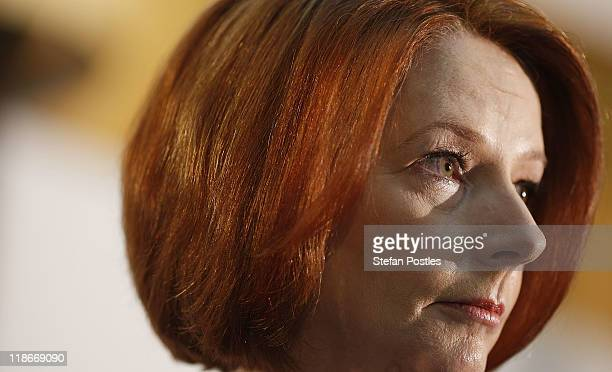Australian Prime Minister Julia Gillard looks on during the government's announcement of the Carbon Tax plan at Parliment House on July 10 2011 in...